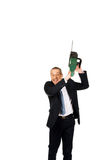 Angry businessman with chainsaw. Furious mature businessman with chainsaw royalty free stock photo