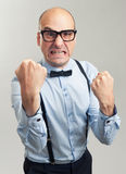 Angry businessman clenched teeth shakes his fist Royalty Free Stock Photo