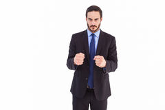 Angry businessman with closed fists looking at camera Royalty Free Stock Photography