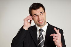 Angry businessman colling Stock Image