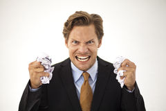 Angry businessman crumbles paper Stock Photography