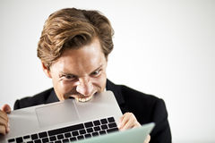 Angry businessman crumbles paper Royalty Free Stock Images