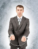 Angry businessman in cuffs Royalty Free Stock Photography