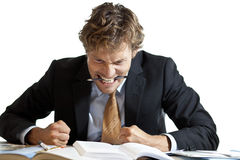 Angry businessman at desk Stock Image