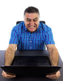 Angry businessman destroying his laptop. Businessman mad crushes his laptop screen with both hands for despair Stock Photography