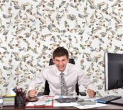 Angry businessman and filling dollar bills Stock Images