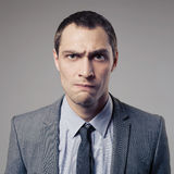 Angry Businessman On Gray Background Royalty Free Stock Image