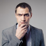 Angry Businessman On Gray Background Stock Image