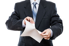 Angry businessman hand tearing paper document royalty free stock photo