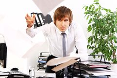 Angry businessman in his office Stock Photos