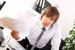 Angry businessman in his office Stock Photography