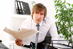 Angry businessman in his office Royalty Free Stock Images
