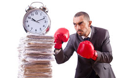 Angry businessman hitting clock isolated Stock Photos