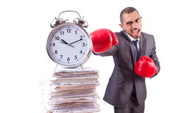 Angry businessman hitting clock isolated Royalty Free Stock Photography