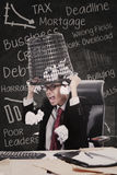 Angry businessman hold rubbish bin in class Royalty Free Stock Image