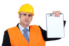 Angry businessman holding a clip board. A angry businessman holding a clip Stock Photography