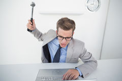 Angry businessman holding hammer over laptop Royalty Free Stock Photography