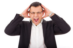 Angry businessman holding head Stock Image