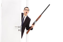Angry businessman holding a shotgun rifle Royalty Free Stock Photo