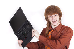 Angry businessman with laptop Stock Image
