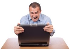 Angry businessman at laptop Stock Photography