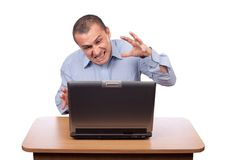 Angry businessman at laptop Stock Image
