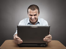Angry businessman at laptop Royalty Free Stock Photography