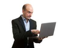Angry businessman with laptop computer Royalty Free Stock Photography