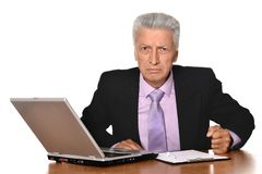 Angry businessman. With a laptop on a light background Stock Image