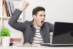 Angry businessman at laptop Royalty Free Stock Photos