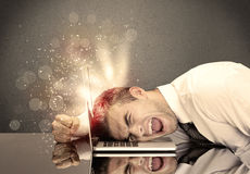Angry businessman with lights and keyboard Stock Image