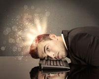 Angry businessman with lights and keyboard Royalty Free Stock Photography