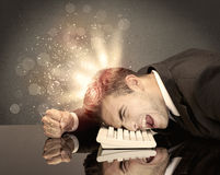 Angry businessman with lights and keyboard Stock Photography