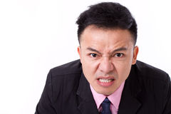 Angry businessman looking at you Stock Photography