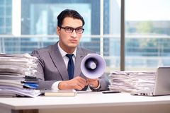 The angry businessman with loudspeaker in the office Stock Photo