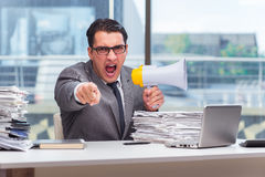 The angry businessman with loudspeaker in the office Royalty Free Stock Photo