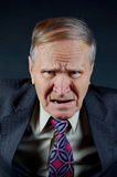 Angry businessman. Angry man yelling on black background Royalty Free Stock Image