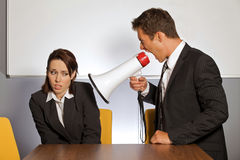 Angry businessman with megaphone Royalty Free Stock Photos