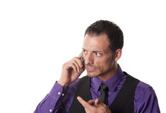 Angry businessman on mobile phone Royalty Free Stock Photos