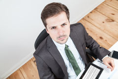 Angry businessman in office Stock Images