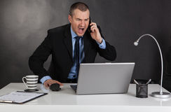 Angry businessman in office Stock Image
