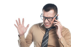 Angry businessman on phone Royalty Free Stock Photography