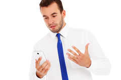 Angry businessman with a phone stock photo