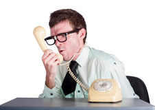 Angry businessman with phone Royalty Free Stock Photo