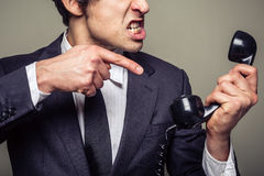 Angry businessman on the phone Royalty Free Stock Photography