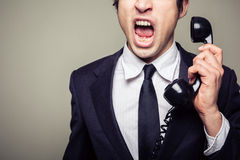 Angry businessman on the phone Royalty Free Stock Images