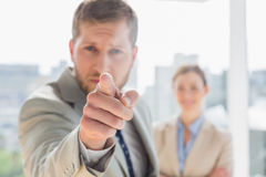 Angry businessman pointing at camera stock photography