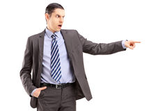 Angry businessman pointing with his finger Stock Image