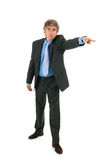 Angry businessman pointing out Royalty Free Stock Image