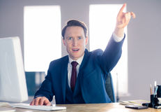 Angry businessman pointing and shouting Royalty Free Stock Image
